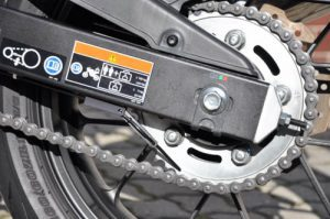 Motorcycle automatic chain oiler
